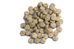 Heap of grassy tablets. On a white background it is isolated Stock Images