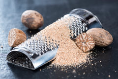 Heap of grated Nutmegs Stock Images