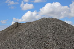 Heap of gravel in front of sky royalty free stock image