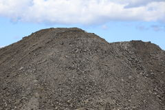 Heap of gravel in front of sky stock images