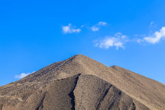 Heap of gravel next to the building Royalty Free Stock Photo