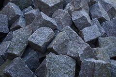 Heap of gray cobbles prepared on the construction site Stock Photo