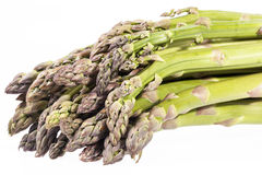 Heap of green asparagus  vegetables isolated on white background Stock Photos