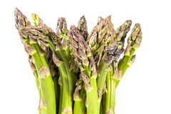 Heap of green asparagus  vegetables isolated on white background Royalty Free Stock Image