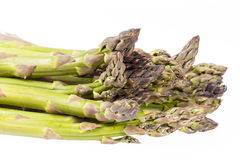 Heap of green asparagus  vegetables isolated on white background Royalty Free Stock Images