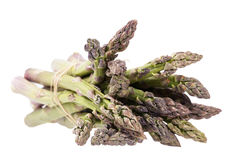 Heap of green asparagus  vegetables isolated on white background Royalty Free Stock Photos