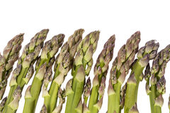 Heap of green asparagus  vegetables isolated on white background Royalty Free Stock Photography