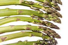 Heap of green asparagus  vegetables isolated on white background Stock Images