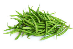 Heap of green beans. Isolated on white stock photos