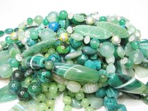 Heap of green colored beads Stock Photos