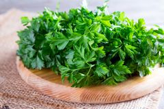 Heap of green fresh raw parsley on old wooden planks. Heap of green fresh raw parsley on wooden planks Royalty Free Stock Image