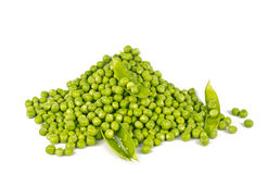 Heap of Green Peas. With some open pods,  on white stock photos