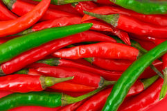 Heap of green and red hot chili pepper Stock Photos