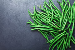 Heap of green or string beans on black stone table top view. Organic and diet food. Stock Image