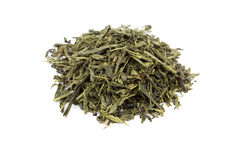 Heap of green tea. Heap of dried green tea leaves isolated on white Stock Image