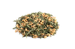 """Heap of Green Tea. Genmai Cha, also known as brown rice tea"""". Japanese green tea mixed with toasted rice isolated on white Royalty Free Stock Images"""