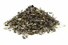 Heap of green tea with jasmine on white background. Close up. High resolution Stock Photography
