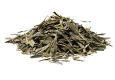 Heap of green tea on white background. Close up. High resolution Royalty Free Stock Images