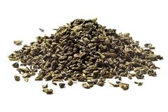 Heap of green tea on white background. Close up. High resolution royalty free stock photos