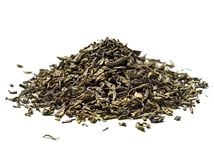 Heap of green tea on white background. Close up. High resolution stock photos