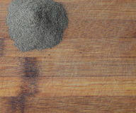Heap of Ground Black Pepper on Wooden Background. Heap of Ground Black Pepper on Old Wooden Background Top View stock photography