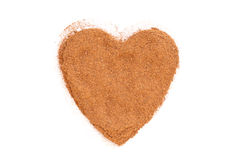 Heap of ground Cinnamon isolated in heart shape stock images