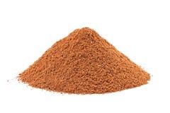 Heap of ground Cinnamon isolated on white. stock photo