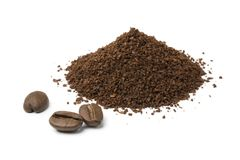 Heap of ground coffee and some coffee beans. Heap of ground coffee and some beans isolated on white background stock photo