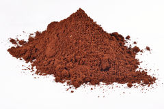 Heap of ground coffee on a white. Background royalty free stock photography