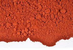 Heap of ground paprika on a white Royalty Free Stock Photo