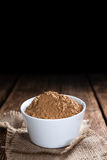 Heap of Guarana Powder. (close-up shot) on wooden background royalty free stock photography