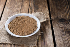 Heap of Guarana Powder. (close-up shot) on wooden background stock image