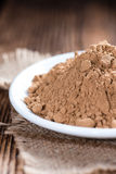 Heap of Guarana Powder. (close-up shot) on wooden background royalty free stock images