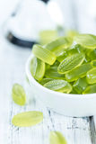 Heap of gummy candy with lime taste. On wooden background (selective focus; close-up shot Royalty Free Stock Photo