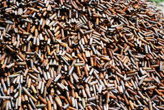Heap of gun bullets tubes. Stack of used bullets oxidated Stock Photos