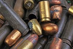 Heap of gun bullets. Weapon Cartridge case sleeve background texture, 7.65, and 9mm. Weapon cartridge sleeves.Gun bullet pattern c. Lose up Stock Photos