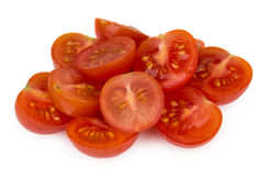 Heap of halved cherry tomatoes isolated on white Stock Photography
