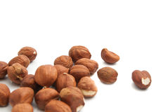 Heap of hazelnuts. Heap of delicious hazelnuts on white background stock images