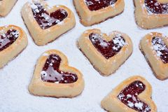 Heap of heart cookies on baking paper Stock Photo