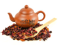 Heap of herbal tea. And cup on white background Royalty Free Stock Images