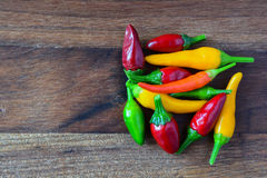Heap of hot red, green and yellow chili peppers Royalty Free Stock Photography
