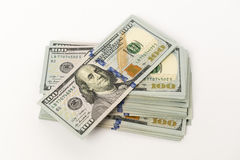 Heap of hundred dollar banknotes on white surface Royalty Free Stock Photos