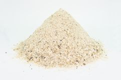 Heap of industrial salt to pour on the streets with medium grain, isolated on white. royalty free stock image