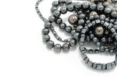 Heap of jet coal beads Royalty Free Stock Photos