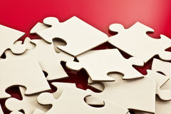 Heap of jigsaw pieces Stock Photos