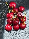 Heap of juicy wet cherries Stock Photos