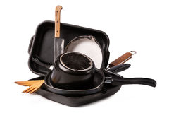 Heap of kitchen bakeware with pan and pot Stock Photography