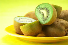 Heap of kiwi on yellow Stock Image