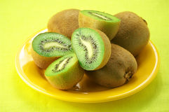 Heap of kiwi on yellow Stock Photo