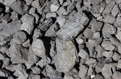 Heap of large and black coal lumps prepared for winter. In sunny day Royalty Free Stock Photos